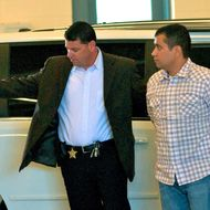 SANFORD, FL- JUNE 3:  George Zimmerman (R) is escorted out of a van in to the Seminole County Jail as he surrenders to authorities after he had his bond revoked because of allegedly misleading the court about his finances June 3, 2012 in Sanford, Florida. George Zimmerman who claims he was acting in self defense has been charged with the murder of unarmed teenager Trayvon Martin.  (Photo by Roberto Gonzalez/Getty Images)
