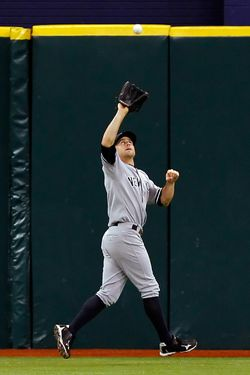 ST. PETERSBURG, FL - JULY 21:  Outfielder Brett Gardner #11 of the New York Yankees catches a fly ball against the Tampa Bay Rays during the game at Tropicana Field on July 21, 2011 in St. Petersburg, Florida.  (Photo by J. Meric/Getty Images)