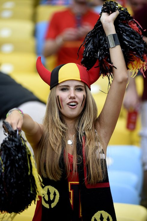 Axelle Despiegelaere, a Belgium fan poses as she waits for the start of the Group H football match between Belgium and Russia at the Maracana Stadium in Rio de Janeiro during the 2014 FIFA World Cup on June 22, 2014.  AFP PHOTO / MARTIN BUREAU