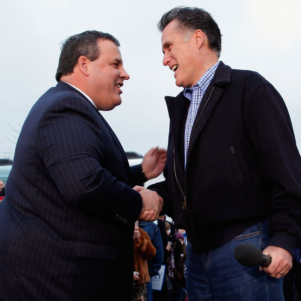 "WEST DES MOINES, IA - DECEMBER 30:  Former Massachusetts Governor and Republican presidential candidate Mitt Romney (R) shakes hands with New Jersey Governor Chris Christie during a campaign rally at a Hy Vee supermarket December 30, 2011 in West Des Moines, Iowa. Christie, a popular Republican governor who was urged to run for president earlier this year, appeared with Romney just days before the ""first in the nation"" Iowa Caucuses.  (Photo by Chip Somodevilla/Getty Images)"
