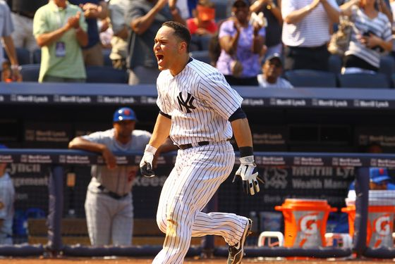 NEW YORK, NY - JUNE 10:  Russell Martin #55 of the New York Yankees celebrates his game winning walk off home run against the New York Mets defeating them 5-4 on June10, 2012 at Yankee Stadium in the Bronx borough of New York City.  (Photo by Al Bello/Getty Images)