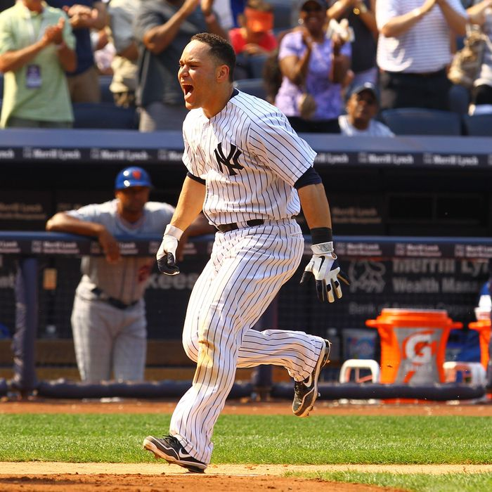 Russell Martin #55 of the New York Yankees celebrates his game winning walk off home run against the New York Mets defeating them 5-4 on June10, 2012 at Yankee Stadium in the Bronx borough of New York City.