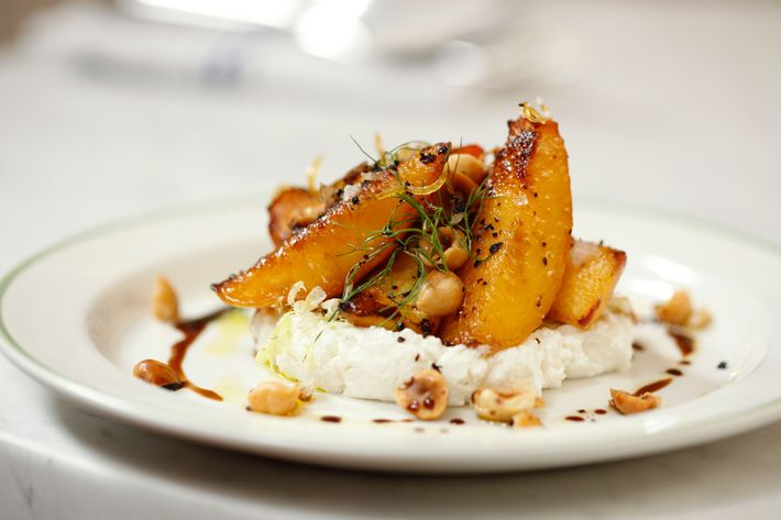 Pesche: charred peaches, sheep's milk ricotta, candied lemon zest, hazelnuts.
