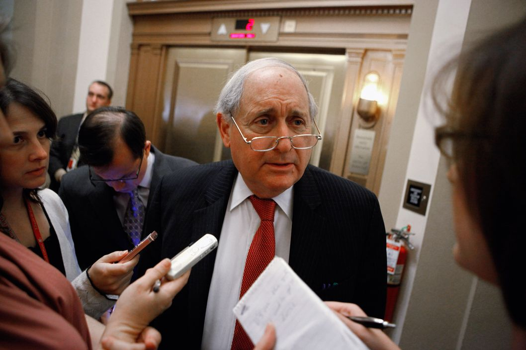 WASHINGTON, DC - DECEMBER 14:  U.S. Sen. Carl Levin (D-MI) talks withe reporters before going into the Senate Democratic Caucus luncheon in the U.S. Captiol December 14, 2010 in Washington, DC. Heavy negotiations are swirling around the Capitol as the Senate hopes to pass the tax-cut compromise bill worked out by Congressional Republicans and President Brarck Obama before the end of this week.  (Photo by Chip Somodevilla/Getty Images) *** Local Caption *** Carl Levin