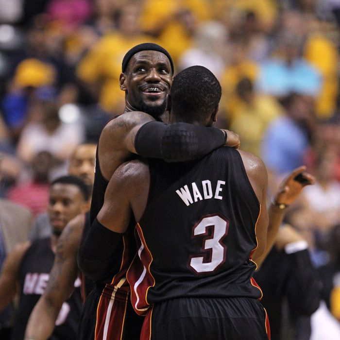 LeBron James #6 of the Miami Heat hugs teammate Dwyane Wade #3 near the end of a win over the Indiana Pacers in Game Four of the Eastern Conference Semifinals in the 2012 NBA Playoffs at Bankers Life Fieldhouse on May 20, 2012 in Indianapolis, Indiana. The Heat defeated the Pacers 101-93.