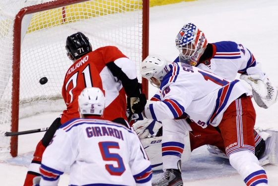 Ottawa Senators' Nick Foligno (71) scores on New York Rangers goaltender Martin Biron as Rangers' Dan Girardi and Marc Staal, defend during first period NHL hockey action in Ottawa, Ontario, on Thursday March 8, 2012. (AP Photo/The Canadian Press, Fred Chartrand)