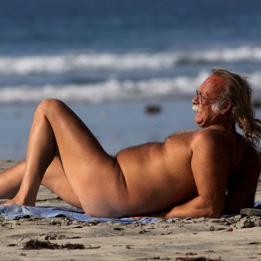 A man sun-bathes while nude at Black's Beach near San Diego, California.  State lawmakers are working to close down all official and un-official nude beaches in California.Nude sun-bathers enjoy a sunny day at Black's Beach near San Diego, California.  State lawmakers are working to close down all official and un-official nude beaches in California.