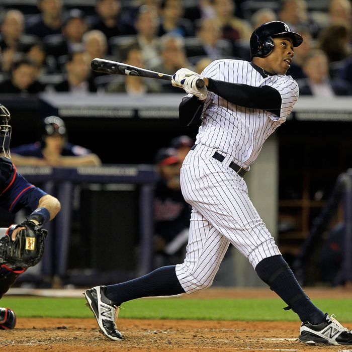 Curtis Granderson #14 of the New York Yankees hits a two run homer in the second inning against the Minnesota Twins on April 19, 2012 at Yankee Stadium in the Bronx borough of New York City.