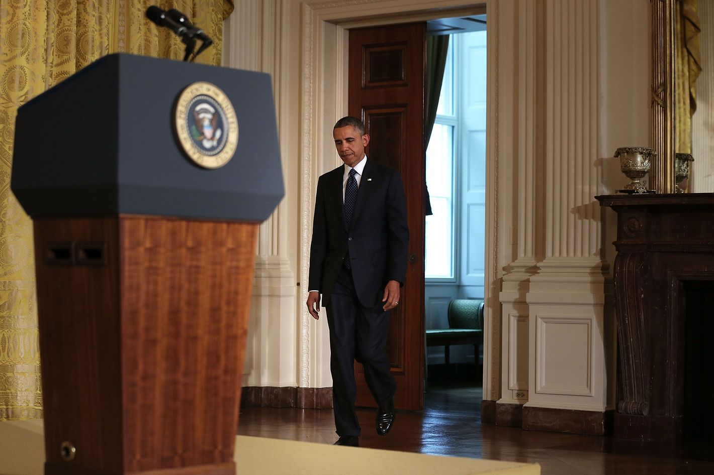 U.S. President Barack Obama approaches the podium to make a statement on the situation regarding the Internal Revenue Service May 15, 2013 at the East Room of the White House in Washington, DC. Obama had a meeting with Senior Treasury Officials, including Treasury Secretary Jack Lew via telephone, on the situation regarding the Internal Revenue Service.