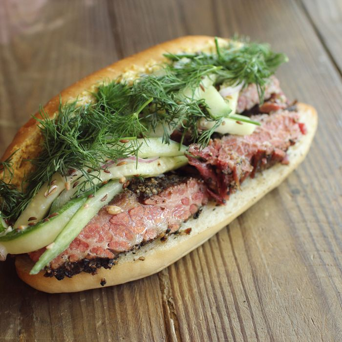 Pastrami with buttermilk fermented cucumbers, dill, and anchovy-Meyer-lemon mustard.
