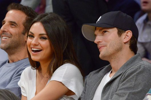 LOS ANGELES, CA - FEBRUARY 12:  Mila Kunis (L) and Ashton Kutcher attend a basketball game between the Phoenix Suns and the Los Angeles Lakers at Staples Center on February 12, 2013 in Los Angeles, California.  (Photo by Noel Vasquez/Getty Images)