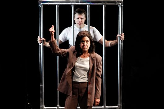 "In this theater publicity image released by Jim Randolph Media Relations, Brent Barrett portrays Hannibal Lecter, background, and Jenn Harris portrays Clarice Starling in a scene from ""Silence! The Musical,"" in New York. The musical is a parody of ""The Silence of the Lambs."" (AP Photo/Jim Randolph Media Relations, Carol Rosegg)"