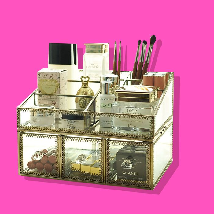 Makeup organizer on pink background.