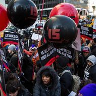 NEW YORK, NY - DECEMBER 04:  Protesters march through the streets demanding a raise on the minimum wage to $15 per hour on December 4, 2014 in New York, United States. The movement, driven largely by fast food workers, has risen in prominence in the past year; today's protests were also joined by demonstrators angry at the Grand jury verdict to not indict the police officer who killed Eric Garner in July, 2014.  (Photo by Andrew Burton/Getty Images)