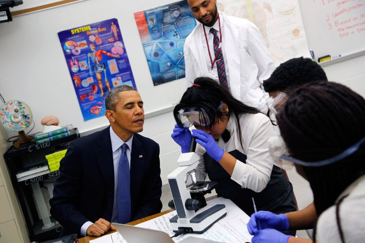 U.S. President Barack Obama visits with students in a 10th grade Microbiology class at Bladensburg High School April 7, 2014 in Bladensburg, Maryland.