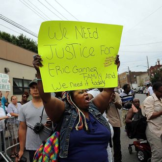 NEW YORK, NY - JULY 19: People participate in a demonstration against the death of Eric Garner after he was taken into police custody in Staten Island on Thursday on July 19, 2014 in New York City. New York Mayor Bill de Blasio announced in a news conference yesterday that there will be a full investigation into the circumstances surrounding the death of Garner. The 400-pound, 6-foot-4 asthmatic, Garner (43) died after police put him in a chokehold outside of a convenience store for illegally selling cigarettes. (Photo by Spencer Platt/Getty Images)