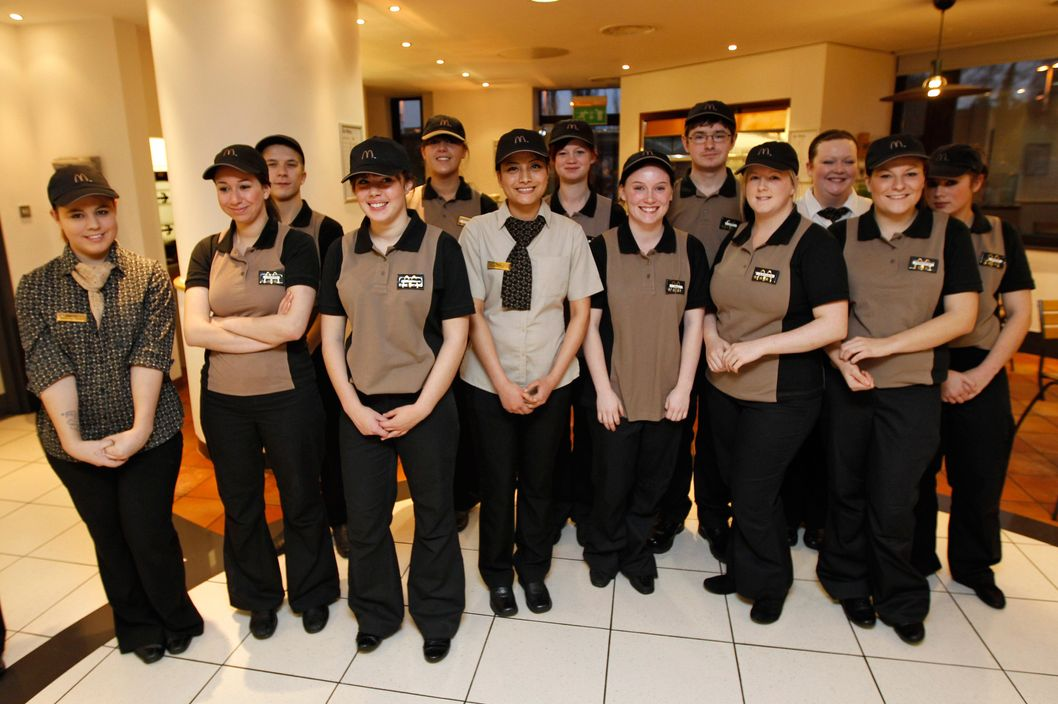 McDonald's staff pose for a photo.