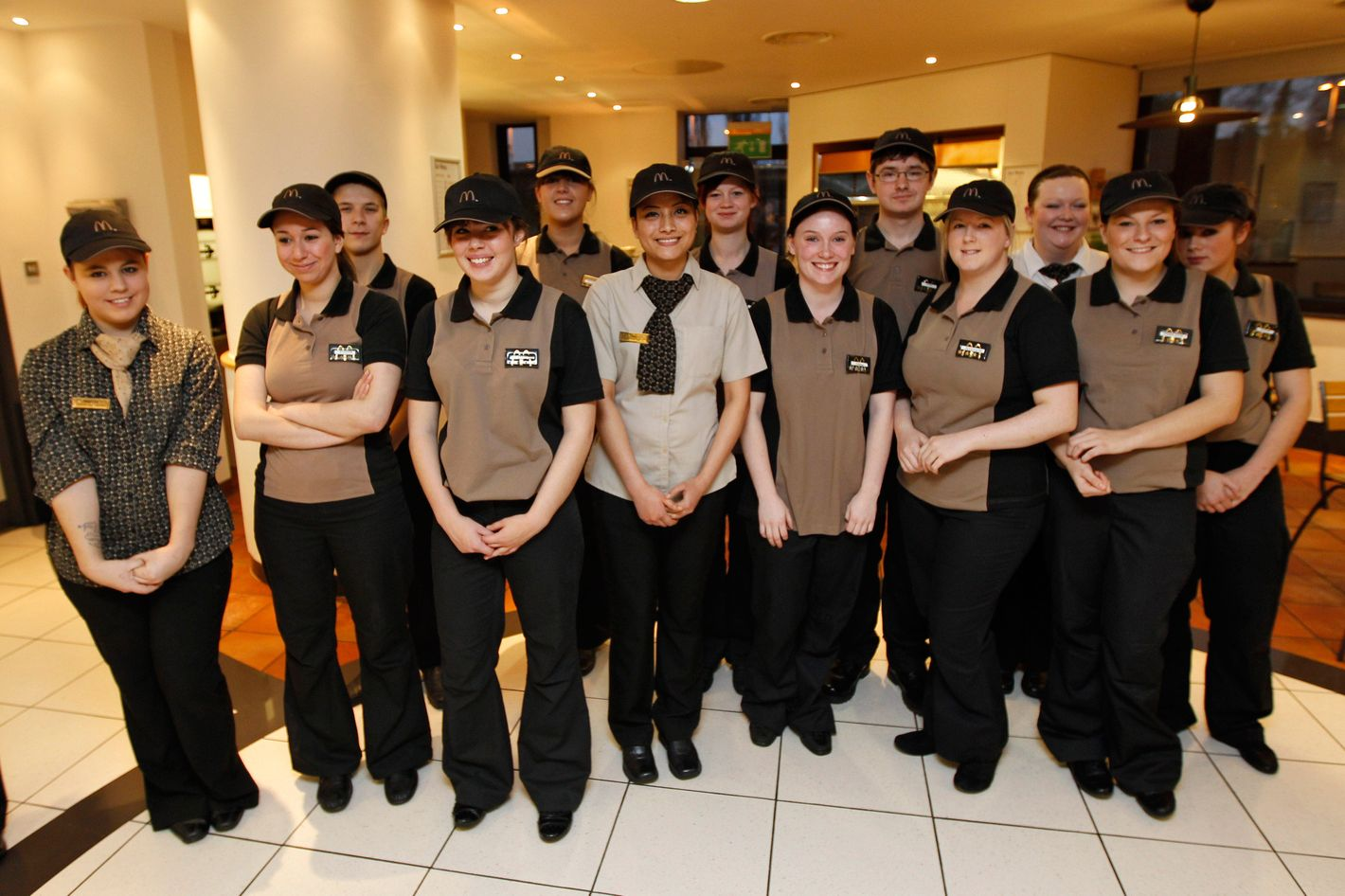 McDonald's staff pose for a photo during a visit from Britain's Deputy Prime Minister Nick Clegg at a training session at the McDonald's Training Center on January 24, 2012 in London, England. McDonald's announced today at least 2,500 new UK jobs this year would be created by the fast food giant. The burger chain expects more than a half of the new posts to go to young people and around 30 percent to first-time workers.