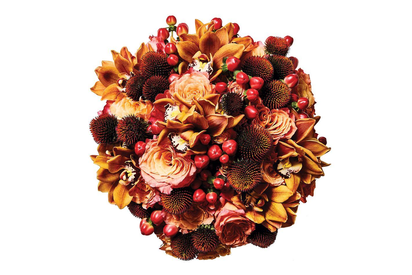 Free Spirit rose, mini orange cymbidium orchid, rudbeckia, and red hypericum berry