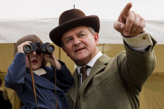 Downton Abbey Season 5 on MASTERPIECE on PBSPart SixSunday, February 8, 2015 at 9pm ETAn ancient spark flares in Violet's heart. While police deepen their probe, Bates tells Anna thetruth. A long and painful mystery is solved.Shown from left to right: Fifi Hart as Sybbie Branson and Hugh Bonneville as Lord Grantham(C) Nick Briggs/Carnival Films 2014 for MASTERPIECEThis image may be used only in the direct promotion of MASTERPIECE CLASSIC. No other rights are granted. All rights are reserved. Editorial use only. USE ON THIRD PARTY SITES SUCH AS FACEBOOK AND TWITTER IS NOT ALLOWED.