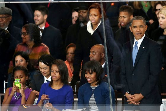 (L-R) Sasha Obama, Malia Obama First lady Michelle Obama and U.S. President Barack Obama watch from the reviewing stand as the presidential inaugural parade winds through the nation's capital January 21, 2013 in Washington, DC. Barack Obama was re-elected for a second term as President of the United States.