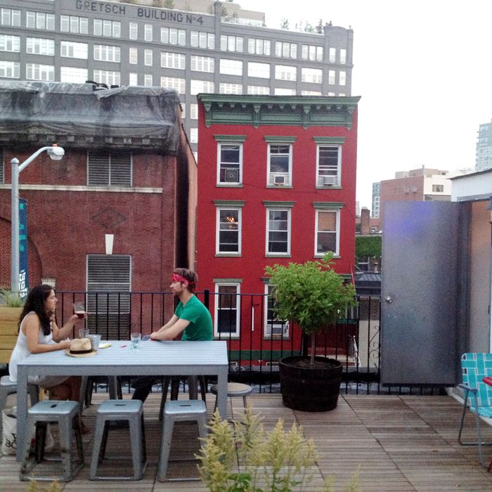 The roof deck feels more like a backyard.
