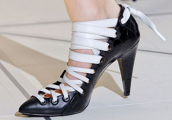 """It's the return of the heel this season. The idea of two-tone shoes is continuing, and you're also seeing a lot of metallics. There were a lot of black shoes on the runway: black and white, black and gold, black and silver.""  <b>Must-have</b>: Balenciaga black and white lace-up pump."