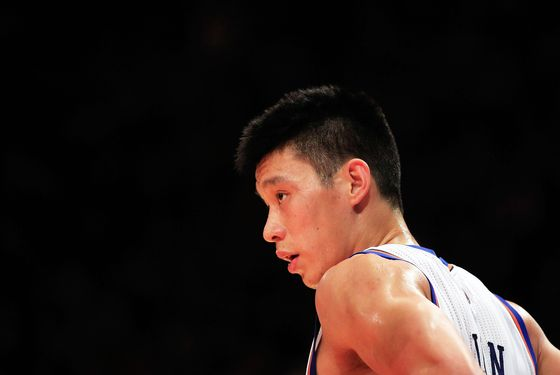 NEW YORK, NY - FEBRUARY 15:  Jeremy Lin #17 of the New York Knicks looks on against the Sacramento Kings at Madison Square Garden on February 15, 2012 in New York City. NOTE TO USER: User expressly acknowledges and agrees that, by downloading and/or using this Photograph, user is consenting to the terms and conditions of the Getty Images License Agreement.  (Photo by Chris Trotman/Getty Images)