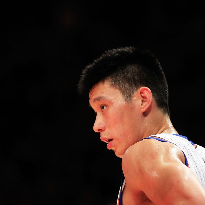 Jeremy Lin #17 of the New York Knicks looks on against the Sacramento Kings at Madison Square Garden on February 15, 2012 in New York City.