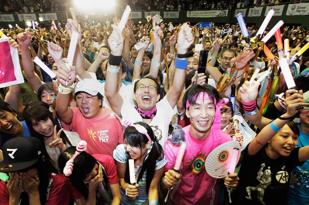 TOKYO, JAPAN - SEPTEMBER 08:  Residents of Olympic bid city Tokyo celebrate after the announcement of the 2020 Summer Olympic Games host city at Komazawa Olympic Park on September 8, 2013 in Tokyo, Japan. Madrid was the first city to be eliminated, followed by Istanbul. Tokyo won the right to host the 2020 Summer Olympic Games in the final ballot.  (Photo by Adam Pretty/Getty Images)