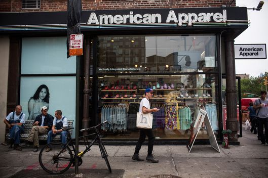 NEW YORK, NY - JUNE 19:  People walk past an American Apparel store on June 19, 2014 in New York City. American Apparel's board has voted to remove the company's controversial CEO, Dov Charney.  (Photo by Andrew Burton/Getty Images)