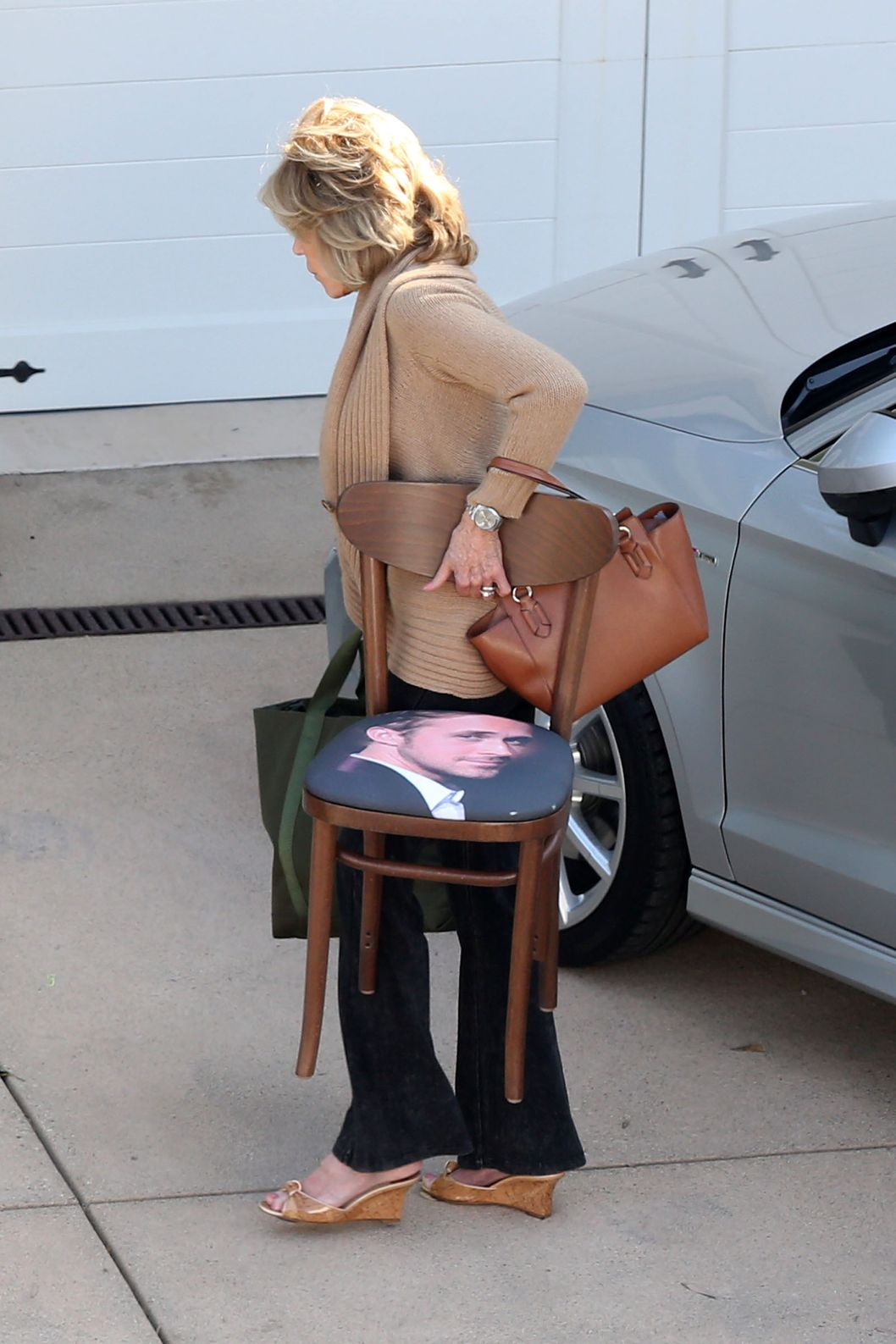 Jane Fonda wears a leg brace between takes on the set of 'Grace and Frankie'.  Fonda took the weight of her feet in between takes of the upcoming tv show which co-stars Martin Sheen and Brooklyn Decker. Jane, who plays Grace in the show, was seen carrying luggage and a chair with Ryan Gosling's face on the seat cover, into a house in Malibu. Fonda waved to fans who had pulled over on the Pacific Coast Highway to try and catch a glimpse of the star.<P>Pictured: Jane Fonda<P><B>Ref: SPL817304  070814  </B><BR/>Picture by: Splash News<BR/></P><P><B>Splash News and Pictures</B><BR/>Los Angeles:	310-821-2666<BR/>New York:	212-619-2666<BR/>London:	870-934-2666<BR/>photodesk@splashnews.com<BR/></P>