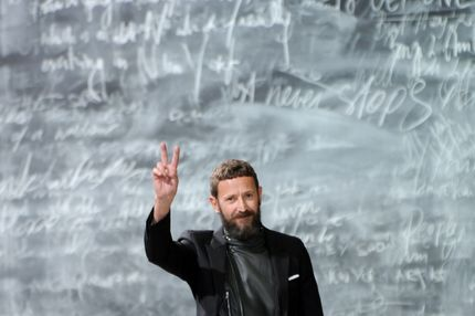 Stefano Pilati on the runway after his Yves Saint Laurent fall 2012 menswear show.