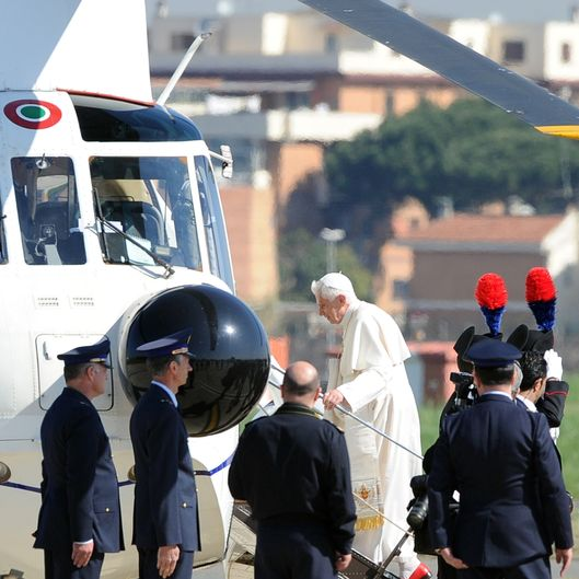 Pope Benedict XVI (C) boards his helicopter for The Vaticcan after his plane arriving from Cuba landed at Rome's Ciampino airport on March 29, 2012. Pope Benedict XVI left Cuba the day before, heading home at the end of his first trip to Spanish-speaking Latin America which also included a visit to Mexico.