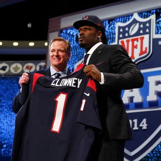 Jadeveon Clowney of the South Carolina Gamecocks stands on stage with NFL Commissioner Roger Goodell after he was picked #1 overall by the Houston Texansduring the first round of the 2014 NFL Draft at Radio City Music Hall on May 8, 2014 in New York City.