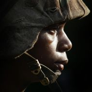 PARRIS ISLAND, SC - JUNE 25: Female Marine Corps recruit Markeisha Richardson, 19, of St. Louis Missouri listens to instructions before going through urban warfare training at the United States Marine Corps recruit depot June 25, 2004 in Parris Island, South Carolina. Marine Corps boot camp, with its combination of strict discipline and exhaustive physical training, is considered the most rigorous of the armed forces recruit training. Congress is currently considering bills that could increase the size of the Marine Corps and the Army to help meet US military demands in Iraq and Afghanistan. (Photo by Scott Olson/Getty Images)
