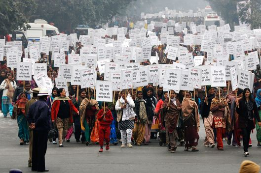 Women hold placards as they march during a rally organized by Delhi Chief Minister Sheila Dikshit (unseen) protesting for justice and security for women, in New Delhi January 2, 2013. India approved on March 21, 2013 a tougher new law to punish sex crimes, including death for repeat rape offenders, after the fatal gang rape of a student in December sparked unprecedented protests over the treatment of women in the country.