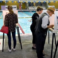 Rafael Sanchez, 90, and Michelle Green vote in the US presidential primary election June 7, 2016 at Echo Deep Pool in Los Angeles, California.
