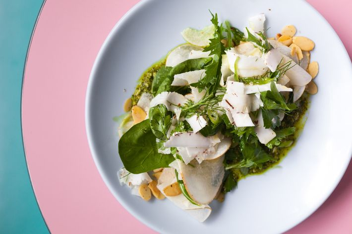 Summer salad with market greens, coconut, and almonds.