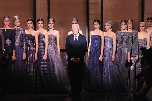 PARIS, FRANCE - JANUARY 21:  Fashion designer Giorgio Armani acknowledges the applause of the audience after the Giorgio Armani Prive show as part of Paris Fashion Week Haute Couture Spring/Summer 2014 on January 21, 2014 in Paris, France.  (Photo by Pascal Le Segretain/Getty Images)