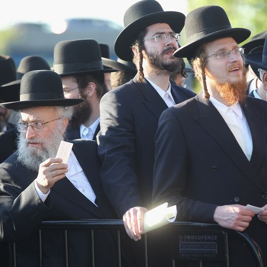 Ultra-Orthodox Jews wait to enter Citi Field for a meeting to discuss the risks of using the Internet on May 20, 2012 in the Queens borough of New York City. More than 40,000 were expected to attend the rally at Citi Field, the home of the New York Mets, which organizers said would promote religiously responsible ways to use the Internet.