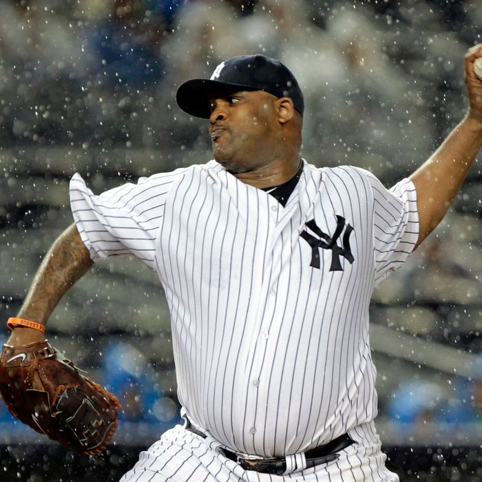 NEW YORK, NY - SEPTEMBER 30: CC Sabathia #52 of the New York Yankees pitches in the rain against the Detroit Tigers during Game One of the American League Division Series at Yankee Stadium on September 30, 2011 in the Bronx borough of New York City. (Photo by Chris Trotman/Getty Images)