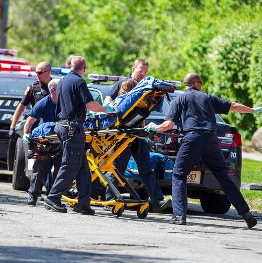 In this Saturday, May 31, 2014 photo, rescue workers take a stabbing victim to the ambulance in Waukesha, Wis. Prosecutors say two 12-year-old southeastern Wisconsin girls stabbed their 12-year-old friend nearly to death in the woods to please a mythological creature they learned about online. Both girls were charged as adults with first-degree attempted homicide Monday in Waukesha County Circuit Court. According to a criminal complaint, the girls had been planning to kill their friend for months and finally made the attempt in a park on Saturday morning, after a slumber party.