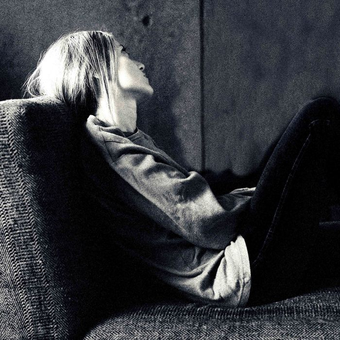 Young woman reclining on couch looking at psychologist