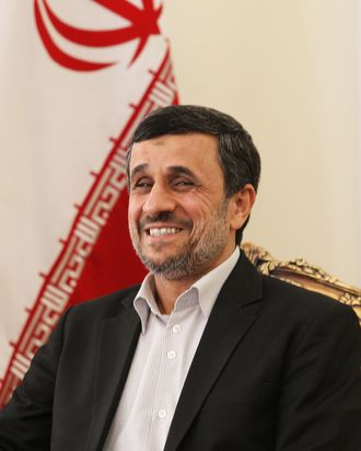 Iran's President Mahmoud Ahmadinejad smiles as he meets his Pakistanese counterpart during a meeting on February 27, 2013 in the Iranian capital Tehran. Pakistan's president arrived in Tehran for discussions on a much-delayed $7.5 billion gas pipeline project which is opposed by the United States, Iranian media reported.