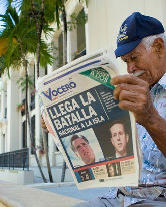 SAN JUAN, PUERTO RICO - MARCH 14: Carlos Diaz, 84, reads local newspaper