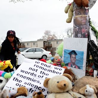 FERGUSON, MO - NOVEMBER 22: Marneisha Jones places a stuff animal at a makeshift memorial for Michael Brown November 22, 2014 in Ferguson, Missouri. Brown, a 18-year-old black male teenager was fatally wounded by Darren Wilson, a white Ferguson Police officer on August 9, 2014. A 12-member grand jury is reviewing evidence to decide whether or not to indict Wilson on charges. (Photo by Joshua Lott/Getty Images)