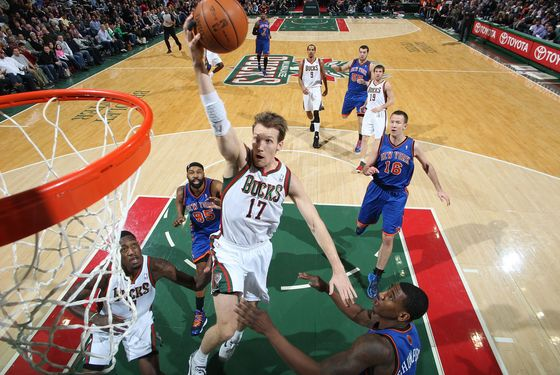 MILWAUKEE, WI - March 09: Mike Dunleavy #17 of the Milwaukee Bucks shoots a layup against Iman Shumpert #21 of the New York Knicks during the game on March 9, 2012 at the Bradley Center in Milwaukee, Wisconsin. NOTE TO USER:  User expressly acknowledges and agrees that, by downloading and or using this Photograph, user is consenting to the terms and conditions of the Getty Images License Agreement.  Mandatory Copyright Notice:  Copyright 2012 NBAE (Photo by Gary Dineen/NBAE via Getty Images)