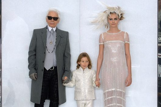 PARIS, FRANCE - JANUARY 21:  (L-R) Fashion designer Karl Lagerfeld, his godson Hudson Kroenig and model Cara Delevingne walk the runway during the Chanel show as part of Paris Fashion Week Haute-Couture Spring/Summer 2014 on January 21, 2014 in Paris, France.  (Photo by Dominique Charriau/WireImage)