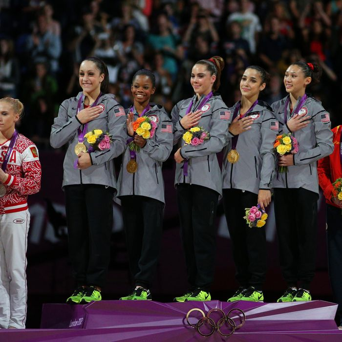 Jordyn Wieber, Gabrielle Douglas, Mc Kayla Maroney, Alexandra Raisman and Kyla Ross of the United States celebrate on the podium after winning the gold medal in the Artistic Gymnastics Women's Team final on Day 4 of the London 2012 Olympic Games at North Greenwich Arena on July 31, 2012 in London, England.